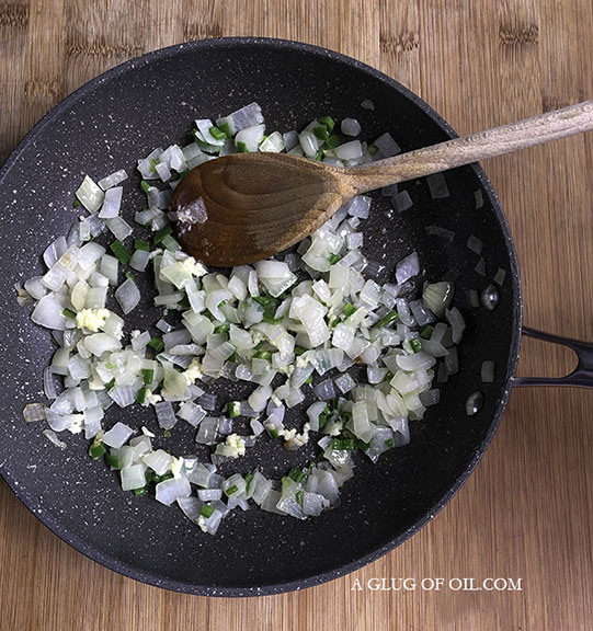 onions garlic and chill in a frying pan