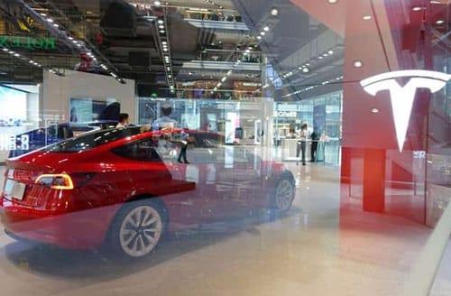 Tesla has a net income of over $1 billion