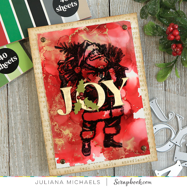 Joy Santa Christmas Card by Juliana Michaels featuring an alcohol ink background, Tim Holtz Vintage Holidays Stamp Set and Scrapbook.com Exclusive Classic Alphabet Dies