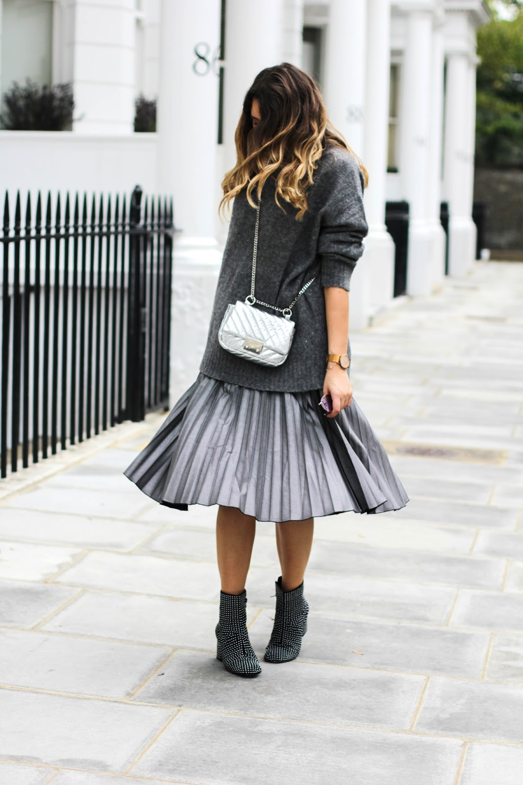 how to wear a pleated midi skirt this winter what s in