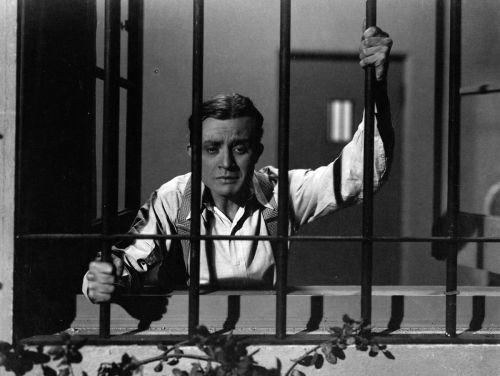 Dwight Frye at barred window