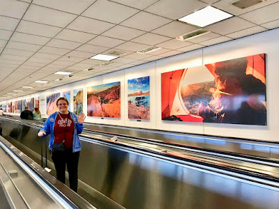 Jennifer, blog author, in the Salt Lake City, Utah airport ready to go to India!