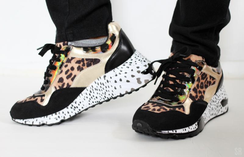 a woman wearing Steve Madden Leopard Sneakers