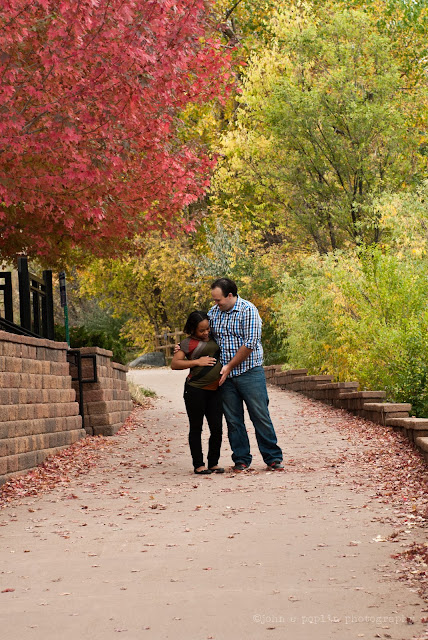 a portrait photo of a pregnant woman and her husband during autumn in Colorado