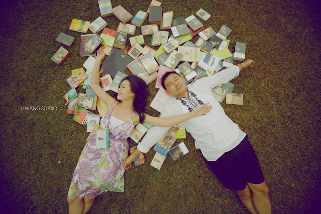 lying on a bunch of books