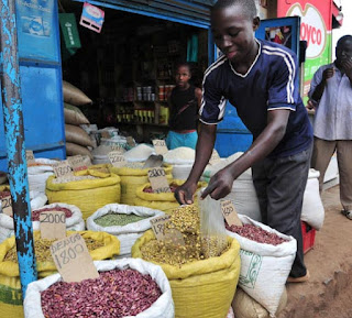 Dry fresh beans for sale on market day in Uganda.