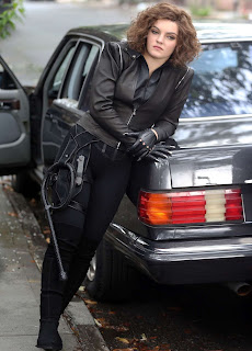 Camren Bicondova posing for picture with car