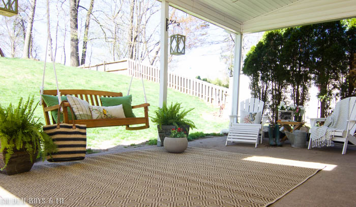 Spring patio refresh with porch swing and covered patio