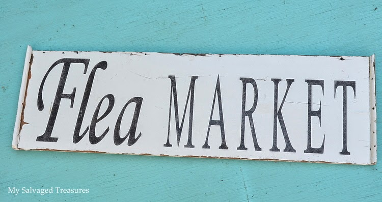 Flea Market sign made from the side of a broken doll cradle.