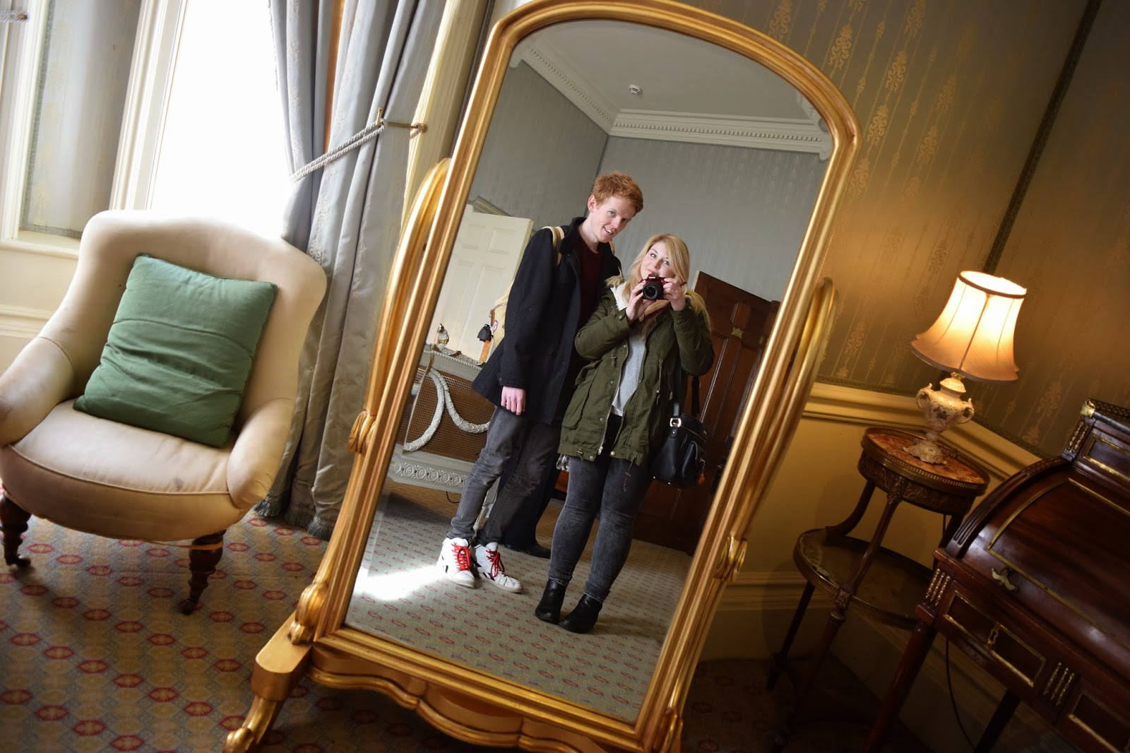 Myself and Sean taking a mirror selfie inside one of the state rooms at warwick castle