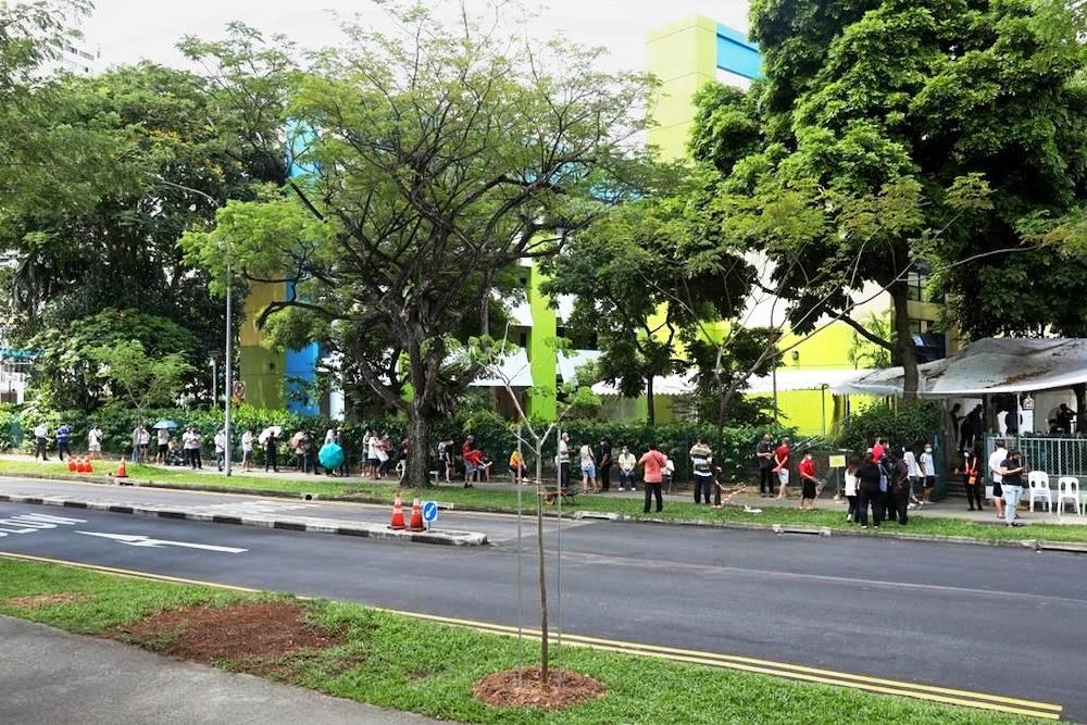 Queues seen outside the former Da Qiao Primary School at Ang Mo Kio, one of the regional screening centres for Covid-19 swab testing, on May 3, 2021