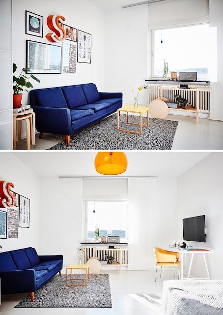 un estudio con un sillon azul, lampara amarilla y paredes blancas en estilo nordico,