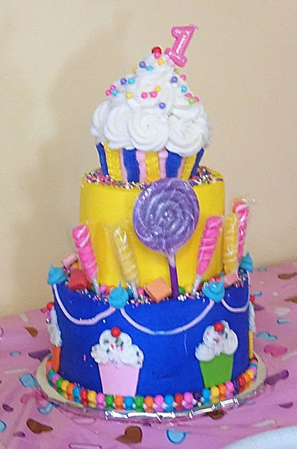 Baby's First Birthday Cake with Candy and Cupcake Decorations