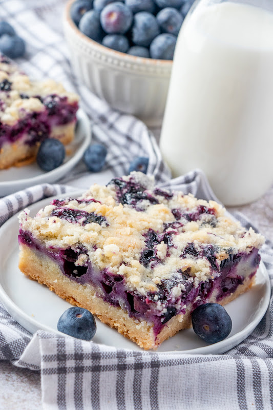 These berry pie bars are a tasty dessert that's great for bake sales, spring and summer picnics, parties and of course, after dinner! Also delicious with cherries, raspberries, blackberries or strawberries!
