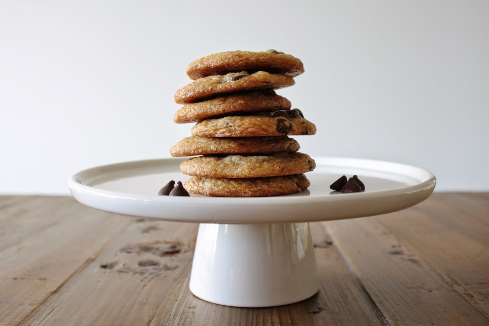 Cookies stacked on a cake stand.