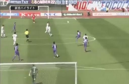 Sanfrecce Hiroshima player Toshihiro Aoyama scores from his own half against Yokohama F. Marinos