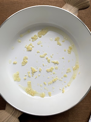 Chopped garlic in pan