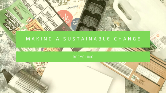Flatlay showing a mix of waste and empty cartons for recycling with the text, making a sustainable change - recycling across the centre