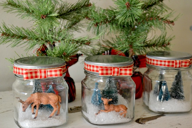 small glass jars with snow scene deer, trees, and deer. www.homeroad.net