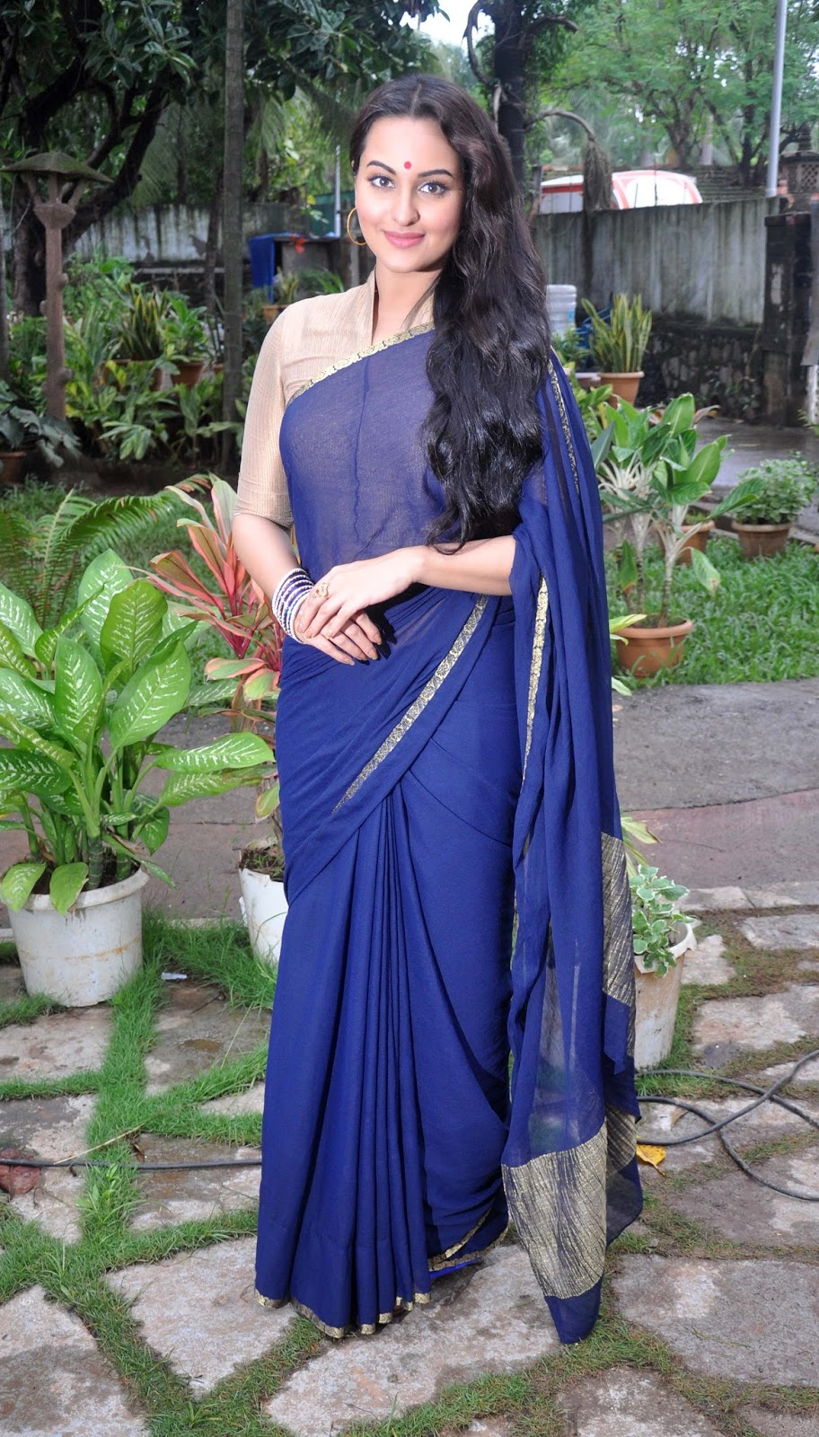 Hot Actress Sonakshi Sinha Long Hair Hip Navel Stills In Blue Saree