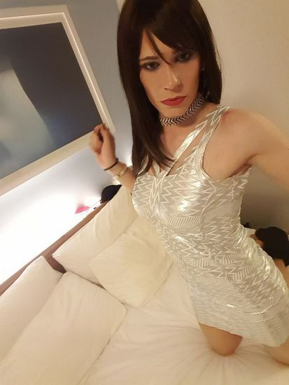 Crossdresser with white dress
