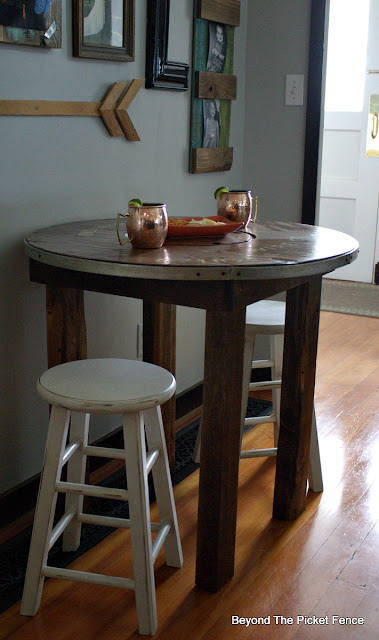 a round table perfect for coffee or cocktails made from an old spool
