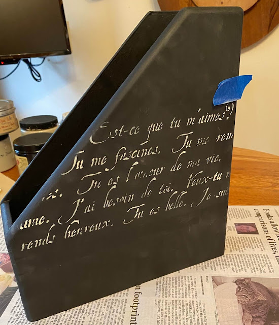 Photo of stenciled French script on wooden file bin