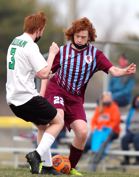 St. Joseph-Ogden's Jared Emmert passes the soccer ball