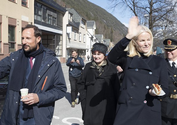 Crown Princess Mette-Marit wore Valentino coat and she wore Prada Brown Knee High Crocodile Boots. Telemark Rjukan-Notodden heritage site