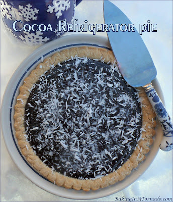 Cocoa Refrigerator Pie is a thick, creamy, chocolatey treat. The filling is cooked in a pan, poured into the crust of your choice and cooled. That's it, decorate and serve. | Recipe developed by www.BakingInATornado.com | #recipe #pie