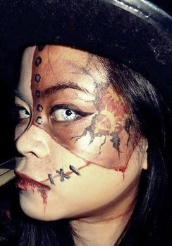 woman wearing steampunk makeup with clockwork contact lenses (clocks with roman numerals) in black and white