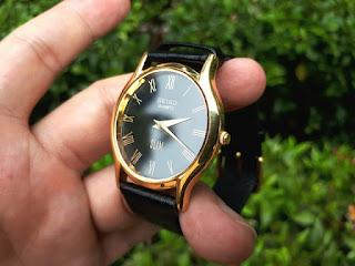 Seiko Slim Quartz Gold Plated Black Roman Dial SK007
