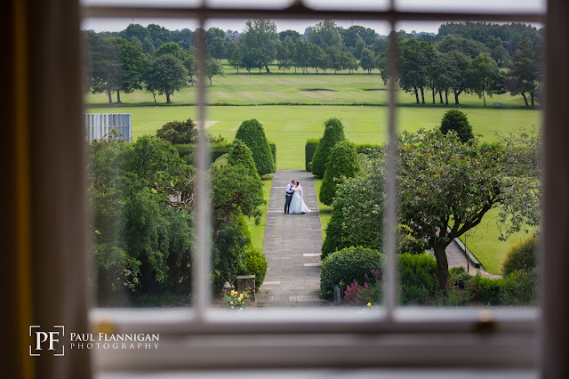bride and groom in grounds of backworth hall