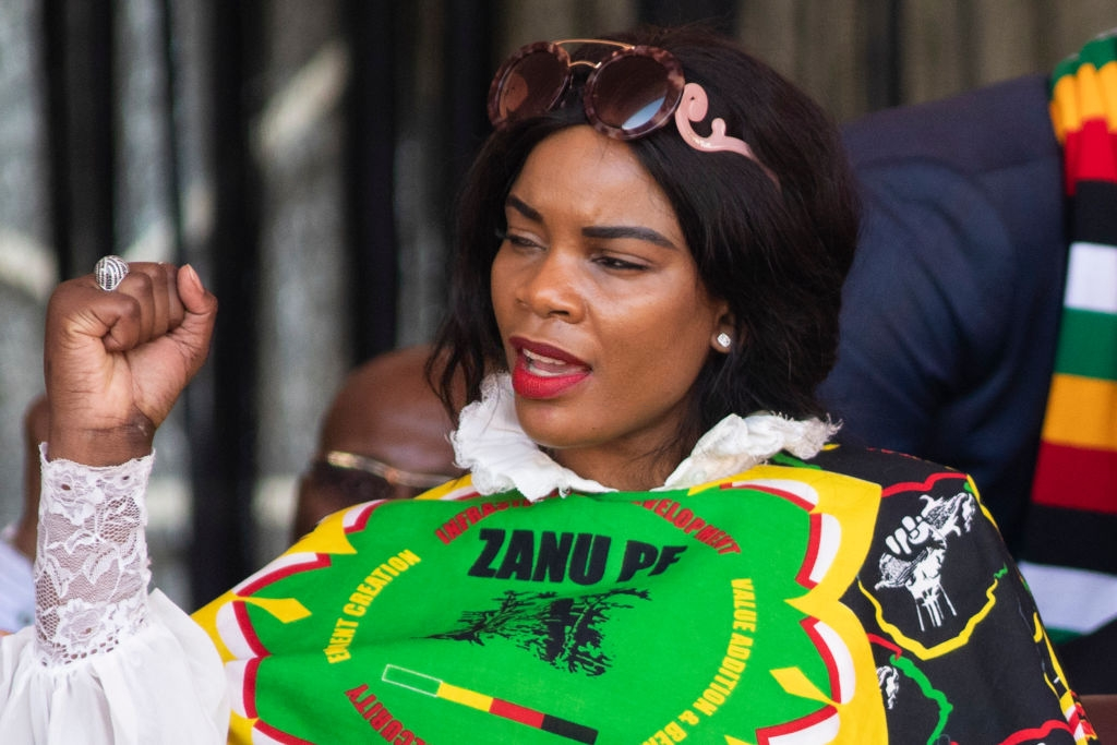 Wife of Former defence force commander General Constantino Chiwenga, Mary Chiwenga listens as Zimbabwe's President Emmerson Mnangagwa delivers his closing presidential campaign at the National Sports Stadium during his final 'Zimbabwe African National Union-Patriotic Front' (Zanu PF) rally on July 28, 2018 in Harare, Zimbabwe. Zimbabweans go to the polls on July 30th to vote for a new president, the first since the end of Robert Mugabe's 37-year rule. (Photo by Dan Kitwood/Getty Images)