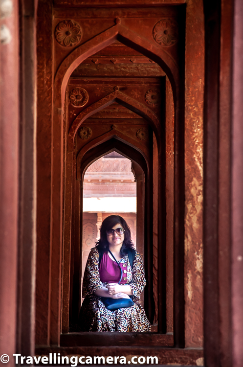 Above photograph shows a portrait clicked through pillars of a heritage building in Rajasthan state of India. Natural framing at times can be very interesting - it's associates the portrait with a place or environment along with enriching overall photograph.     Portraits of people in action :