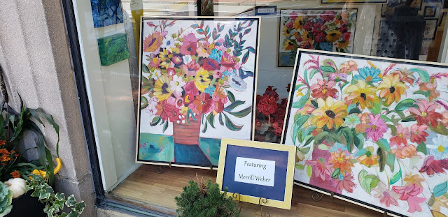 merrill weber's floral paintings in the window at visual expansion art gallery