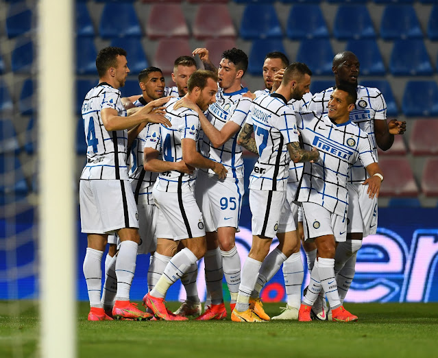 Inter Milan players celebrate as they take a step closer to lifting the Serie A title