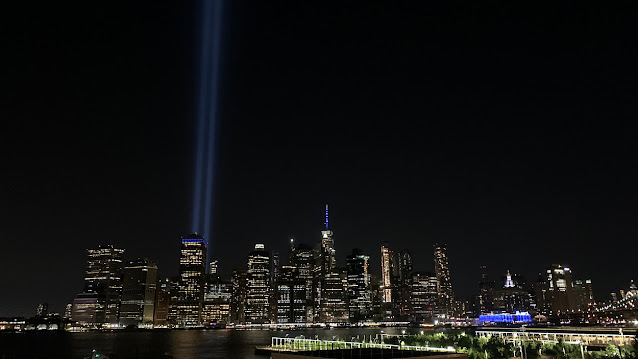 Photo of the Tribute in Light - two blue searchlights reaching into the sky.