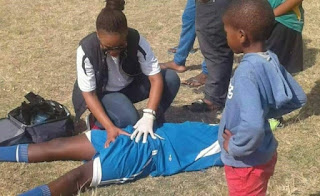 photo of a female medical personnel attending to a male footballer goes viral