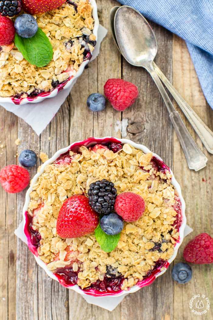 Get your berry crisp fix with these easy individual desserts that are full of raspberries, blackberries, blueberries and strawberries topped with a crunchy oatmeal topping.