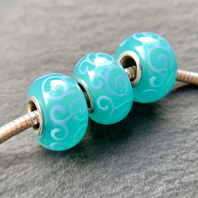 Handmade lampwork glass silver core big hole charm beads by Laura Sparling made with CiM Toothpaste