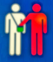 Image of person with a hand in another person's purse