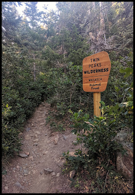 Sign letting you know that this trail is in the Twin Peaks Wilderness Area
