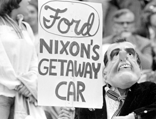Nixon protest signs. Protester in Nixon mask. Ford - Nixon's getaway car. Misspelled Impeach. marchmatron.com
