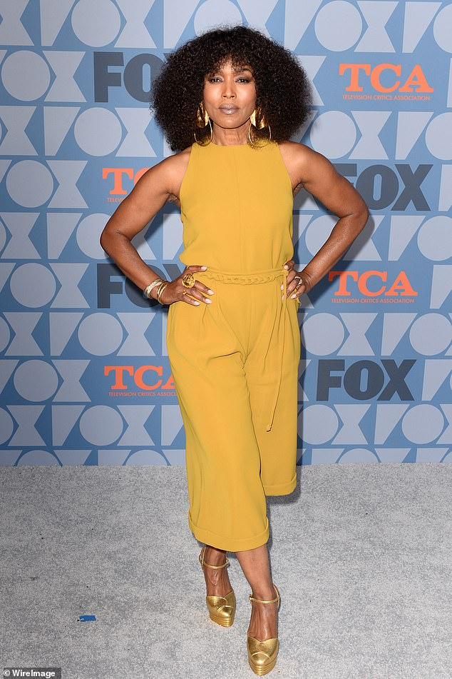 Angela Bassett, 60, looks gorgeous in sleeveless culotte jumpsuit and dramatic earrings at Fox event in LA
