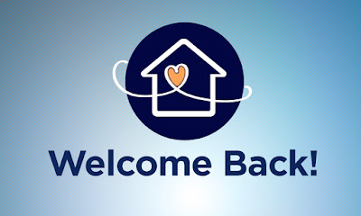 "Light blue background with a dark blue circle. In the circle is an outline of a house in white and a white curving line that forms a heart in the middle of the house. Text reads ""Welcome Back!"""