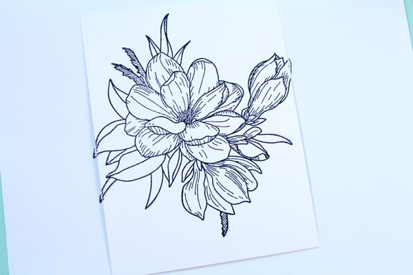 Make a handmade card with floral stamps.