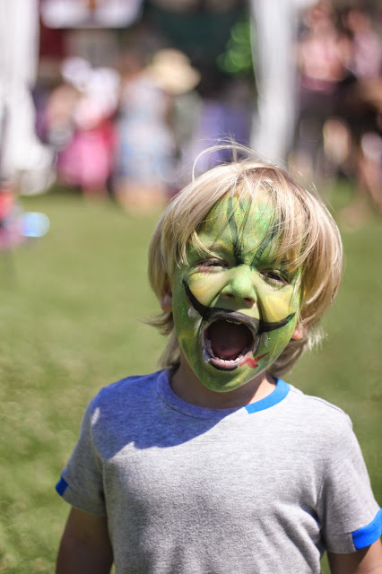 face painted dinosaur