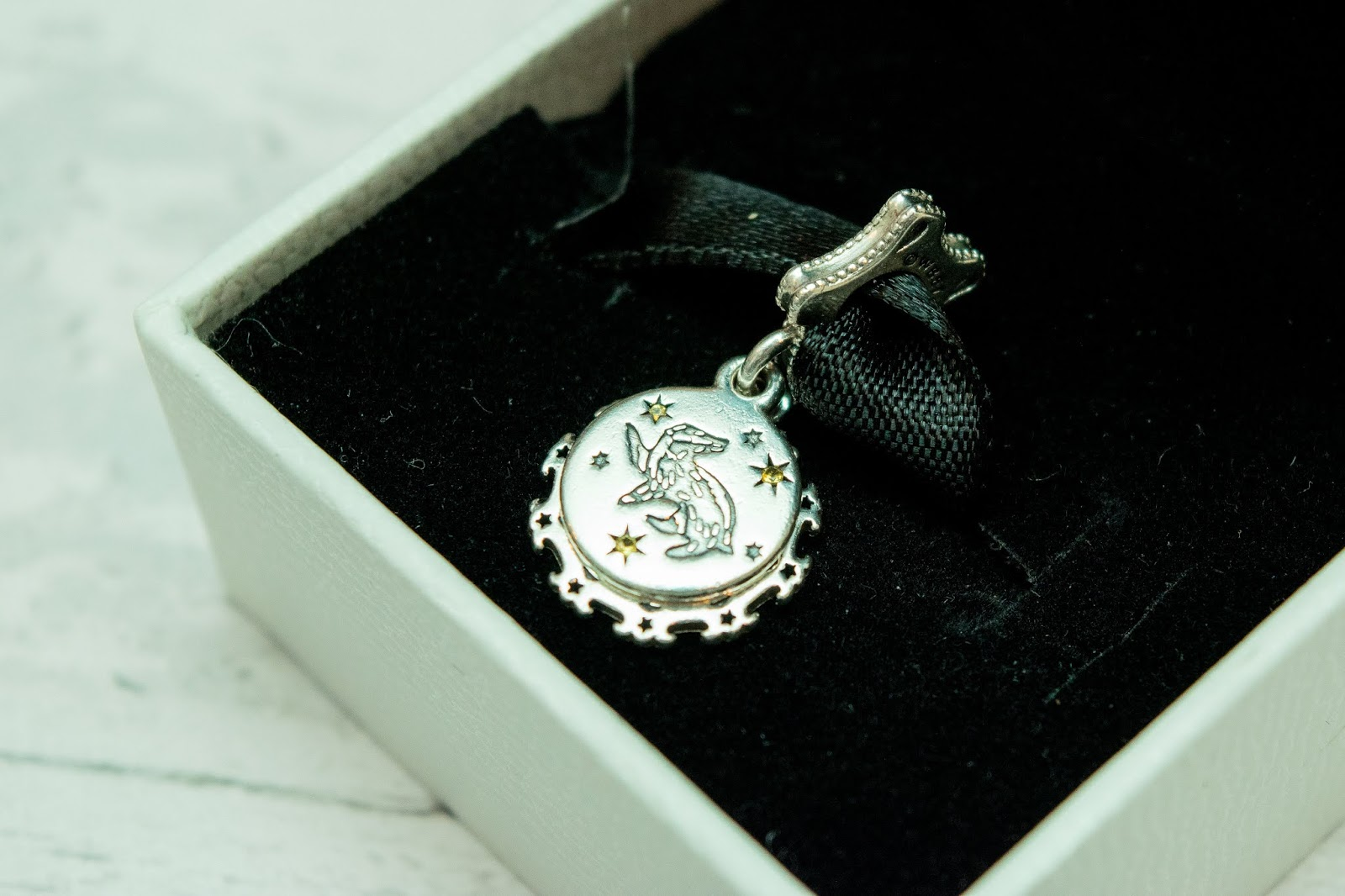 A Pandora charm with the Hufflepuff badge engraved into it.