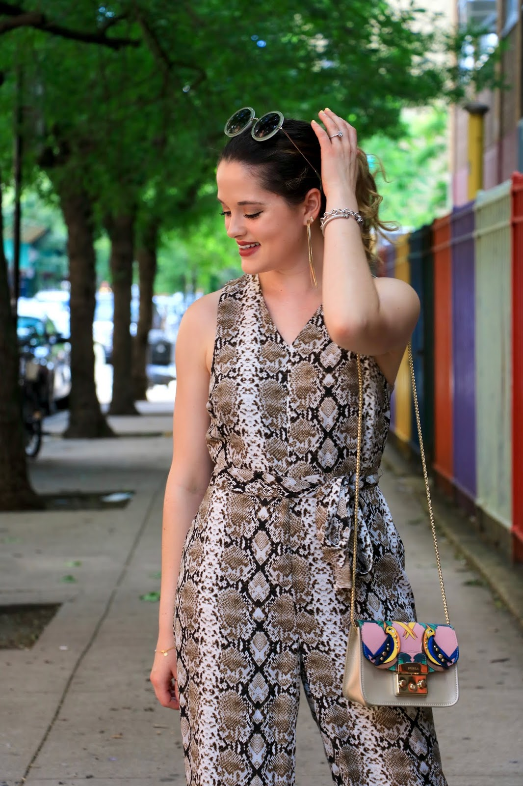 Nyc fashion blogger Kathleen Harper wearing a snake print jumpsuit from Banana Republic.